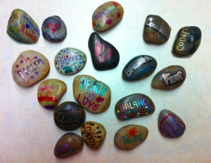 "In our lives, there are many ""stepping stones"" - events or hopes that lead us from one stage to another.  In this workshop, we asked the women to create a stepping stone symbolizing something they wanted to step away from, and a stepping stone embodying something they wanted to move toward.  These beautiful creations are the result."